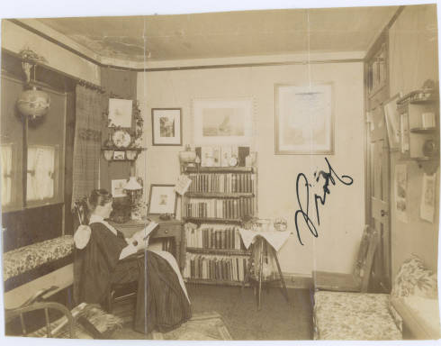 Student reading in her dorm room