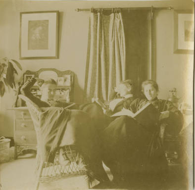 Anna M. Haas reading with friends, 1898