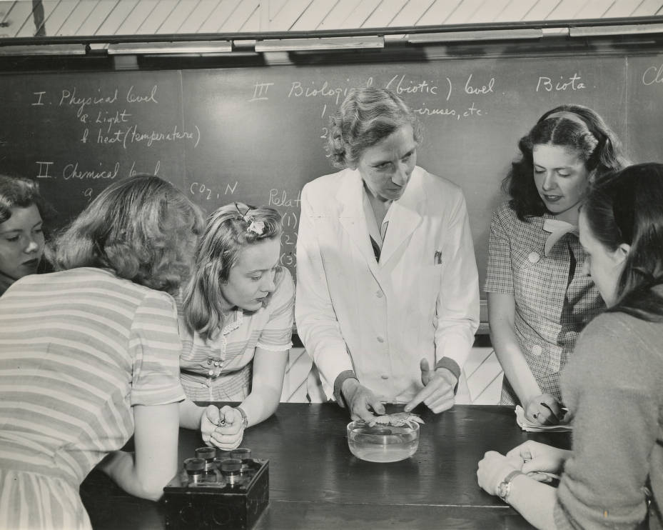 Students with professor in biology laboratory